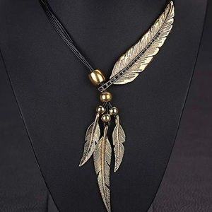 Gold alloy feather rhinestone accent necklace